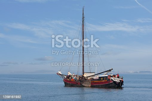 Lelystad, The Netherlands - September 19, 2009: Traditional wooden sailing ship with passengers sailing at Dutch sea IJsselmeer