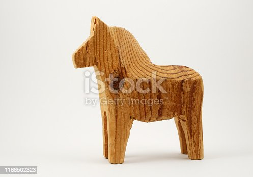 traditional wooden toy horse on a white background