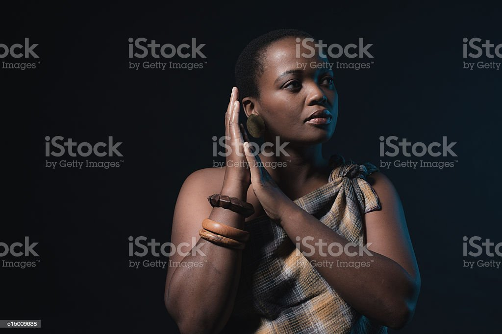Traditional xhosa woman wearing brown fabric and bracelets. stock photo
