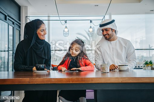 istock Traditional Young Arab family enjoying at cafe 476208740