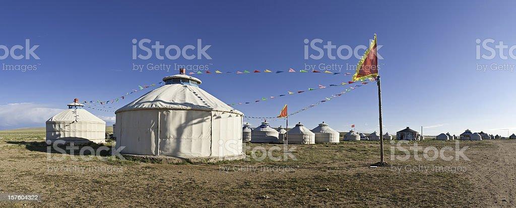 Traditional yurt tent village flags Inner Mongolian grasslands panorama China royalty-free stock photo