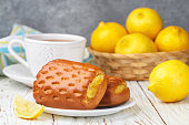 Traditionall Breakfast. Fresh homemade buns with lemon and tea. Rustic style. Selective focus