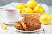 Traditionall Breakfast. Fresh homemade cakes with lemon and tea. Rustic style. Selective focus