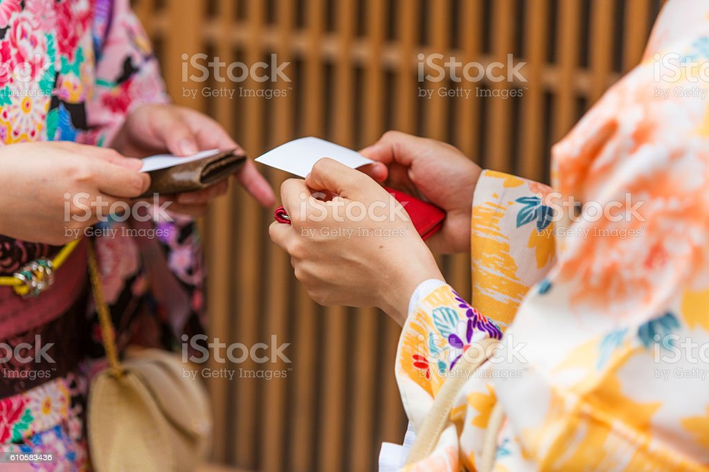 Traditionally dressed japanese women in kimonos greet each other traditionally dressed japanese women in kimonos greet each other royalty free stock photo m4hsunfo