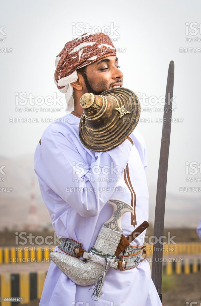 traditionally dressed omani man stock photo
