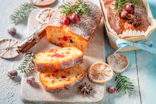 Traditionally Fruitcake for Christmas decorated with sugar powder stock photo