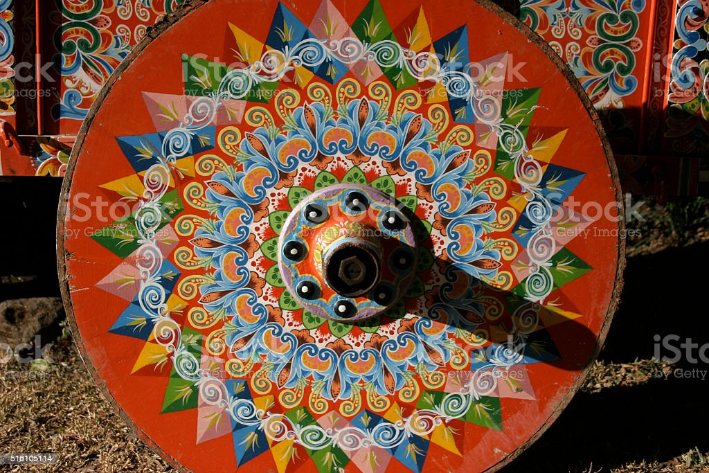 Traditionally painted ox cart wheel From Costa Rica stock photo