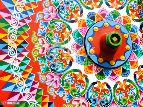 Traditionally painted ox cart wheel. This is a traditional form of decorating ox carts in the town of Sarchi, Costa Rica.