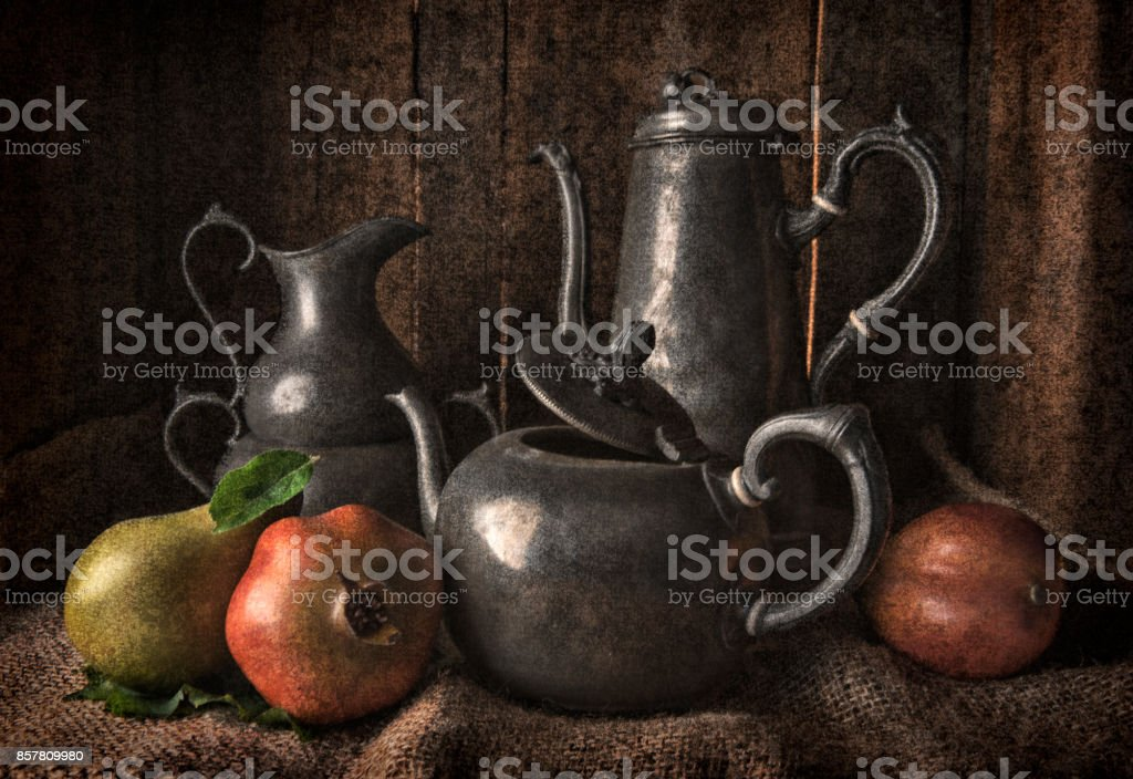 A traditionally styled still life of pewter vessels stock photo