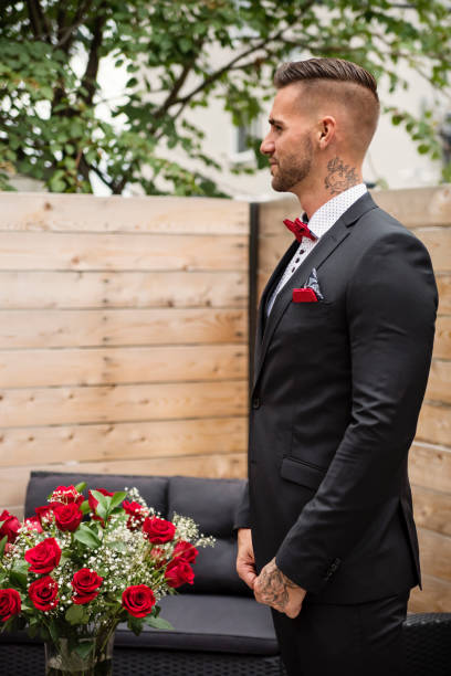 Traditionnal portrait of millenial groom before wedding. stock photo