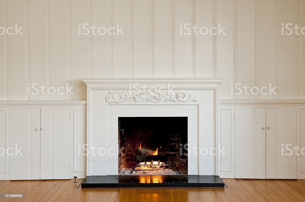 Traditonal Fireplace In Empty Room stock photo