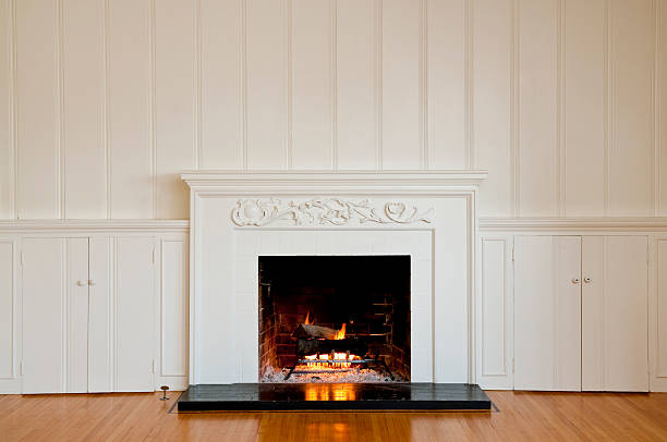 traditonal fireplace in empty room - fireplace stockfoto's en -beelden