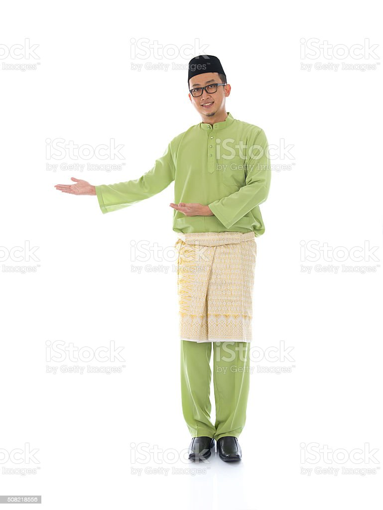 Traditonal Malay man with welcome gesture during ramadan isolate stock photo