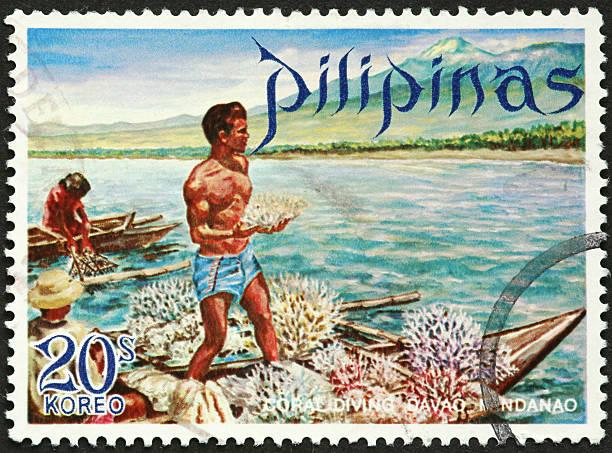 traditonal Philippine coral diver stock photo