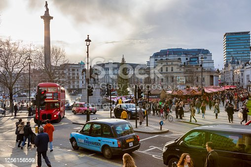 London, United Kingdom -Dec 11, 2019: Busy afternoon at Trafalgar square. Locals and tourists visiting the most famous square in UK and the National gallery