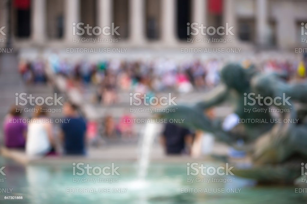 Trafalgar square with lots of people. Blurred image stock photo