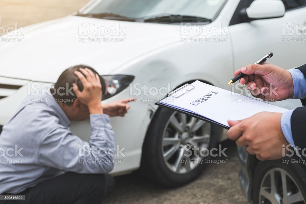 Traffic Accident and insurance concept, Insurance agent working on report form with car accident claim process stock photo