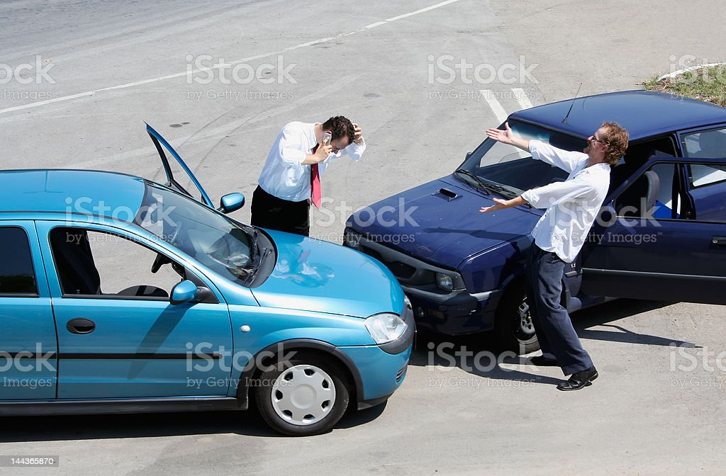 Traffic accident and two drivers fighting royalty-free stock photo