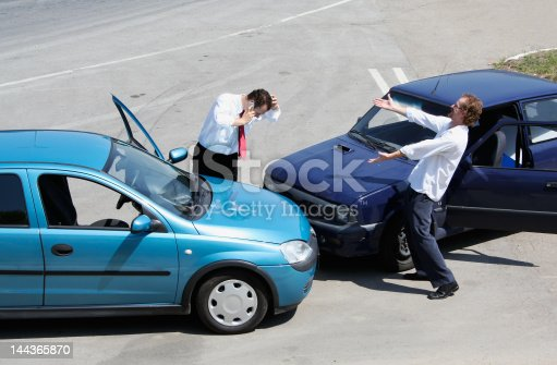 1047083324 istock photo Traffic accident and two drivers fighting 144365870
