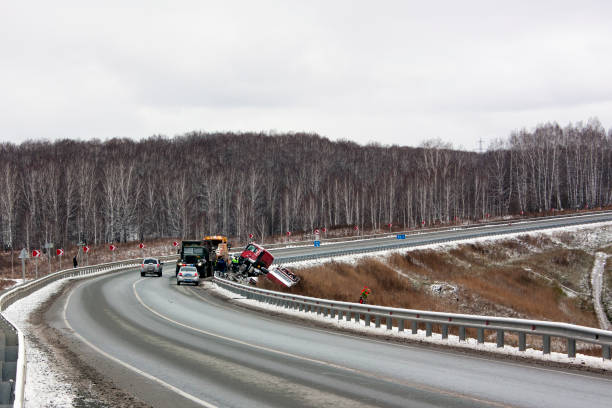 Traffic accident with a truck. MAN truck on a slippery corner road flew into a ditch stock photo
