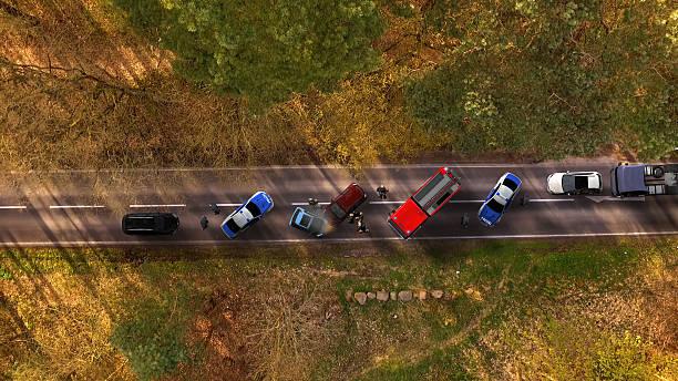 traffic accident with vehicles on a highway aerial view - krockad bil bildbanksfoton och bilder