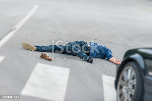 istock Traffic accident.Young man hit by a car 489601544