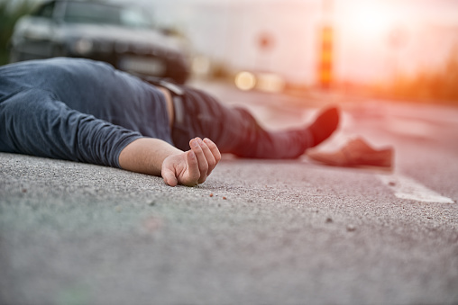 Traffic accident.Young man hit by a car