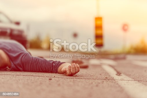 istock Traffic accident.Young man hit by a car 504852484
