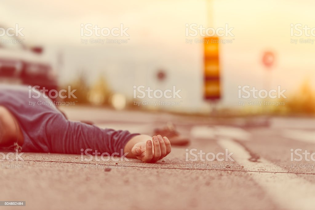 Traffic accident.Young man hit by a car stock photo