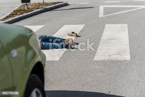 905971060istockphoto Traffic accident.Young man hit by a car 650700406