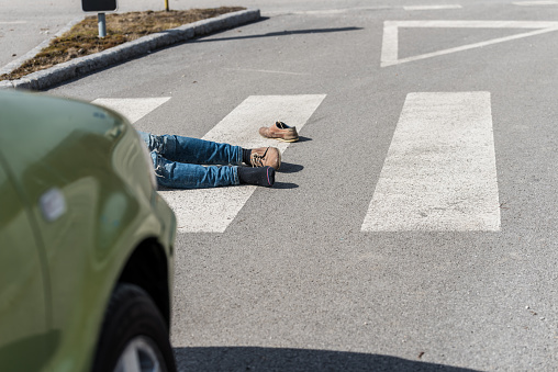 905971060 istock photo Traffic accident.Young man hit by a car 650700406