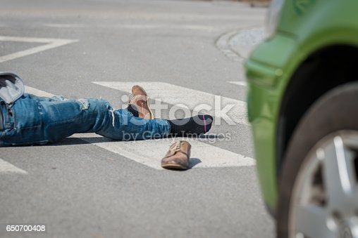 905971060istockphoto Traffic accident.Young man hit by a car 650700408