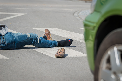 905971060 istock photo Traffic accident.Young man hit by a car 650700408