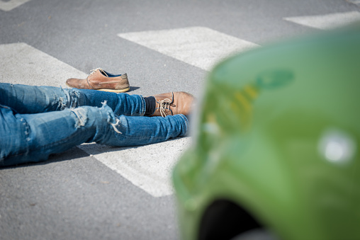 905971060 istock photo Traffic accident.Young man hit by a car 650700416