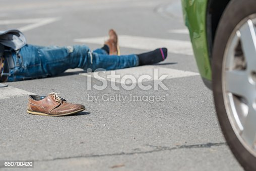 905971060istockphoto Traffic accident.Young man hit by a car 650700420