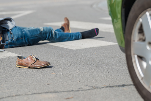 905971060 istock photo Traffic accident.Young man hit by a car 650700420