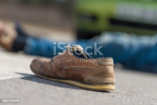 905971060istockphoto Traffic accident.Young man hit by a car 650700440