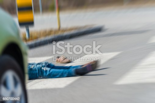 905971060istockphoto Traffic accident.Young man hit by a car 650700442