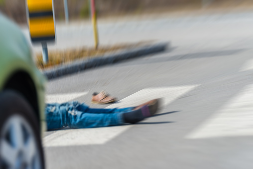 905971060 istock photo Traffic accident.Young man hit by a car 650700442