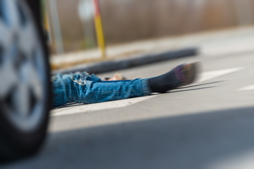 905971060 istock photo Traffic accident.Young man hit by a car 650700446