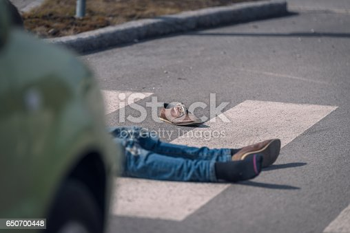 905971060istockphoto Traffic accident.Young man hit by a car 650700448