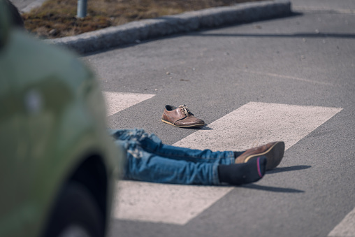 905971060 istock photo Traffic accident.Young man hit by a car 650700448