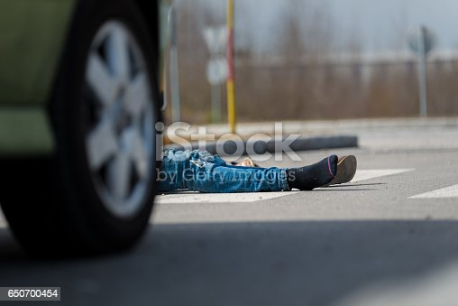 905971060istockphoto Traffic accident.Young man hit by a car 650700454