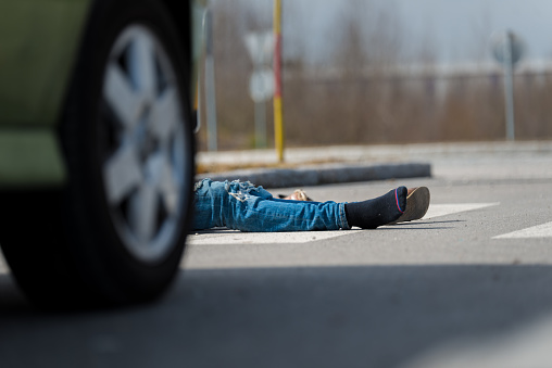 905971060 istock photo Traffic accident.Young man hit by a car 650700454