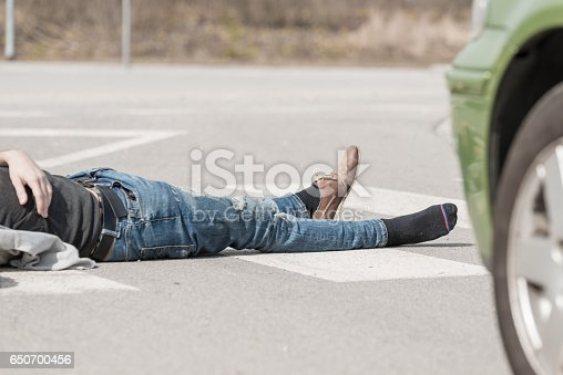 905971060istockphoto Traffic accident.Young man hit by a car 650700456