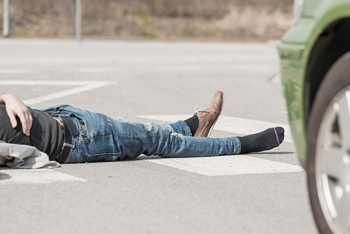 905971060 istock photo Traffic accident.Young man hit by a car 650700456