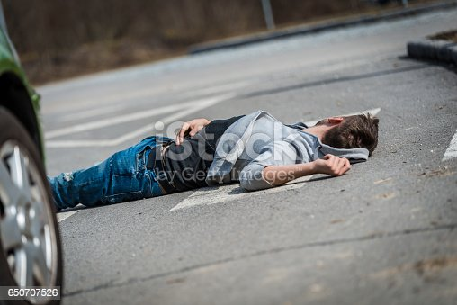 905971060istockphoto Traffic accident.Young man hit by a car 650707526