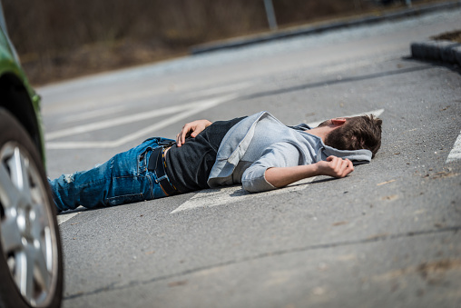 905971060 istock photo Traffic accident.Young man hit by a car 650707526