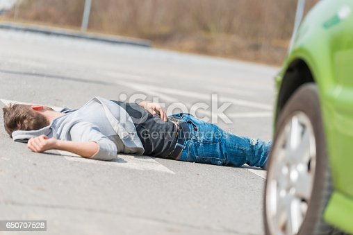 905971060istockphoto Traffic accident.Young man hit by a car 650707528
