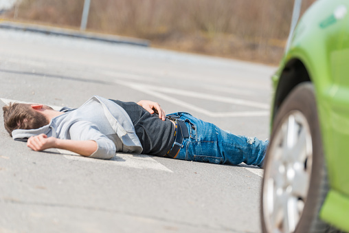 905971060 istock photo Traffic accident.Young man hit by a car 650707528